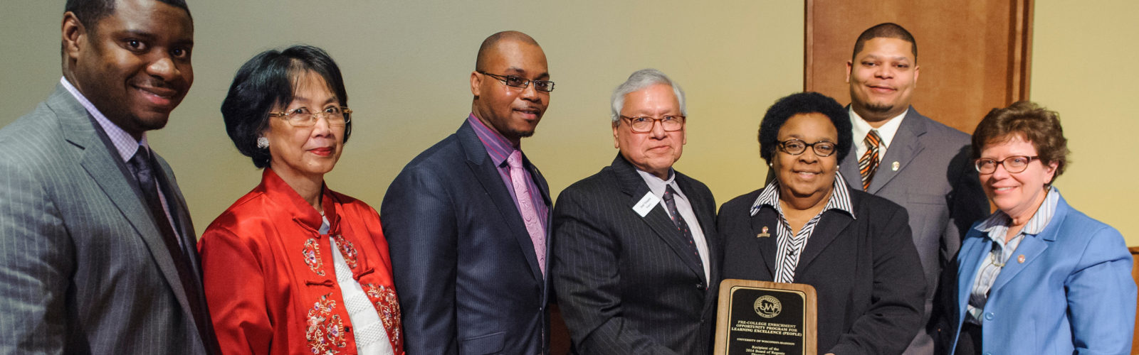 Members of the UW-Madison PEOPLE program, including executive director Jacqueline DeWalt (with award right), receive a Regents Diversity Award from UW regent José Vásquez (with award left) during a UW Board of Regents meeting hosted at Union South at the University of Wisconsin-Madison on Feb. 7, 2014. UW-Madison chancellor Rebecca Blank is pictured at right. (Photo by Bryce Richter / UW-Madison)