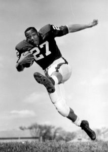 Lou Holland, Sr., was a Badger Hall of Fame halfback who led the Big Ten in scoring in 1962 and 1963. Wisconsin Athletics