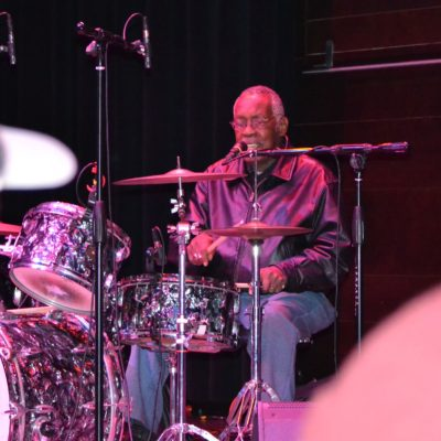 Clyde Stubblefield playing the drum on stage in 2013