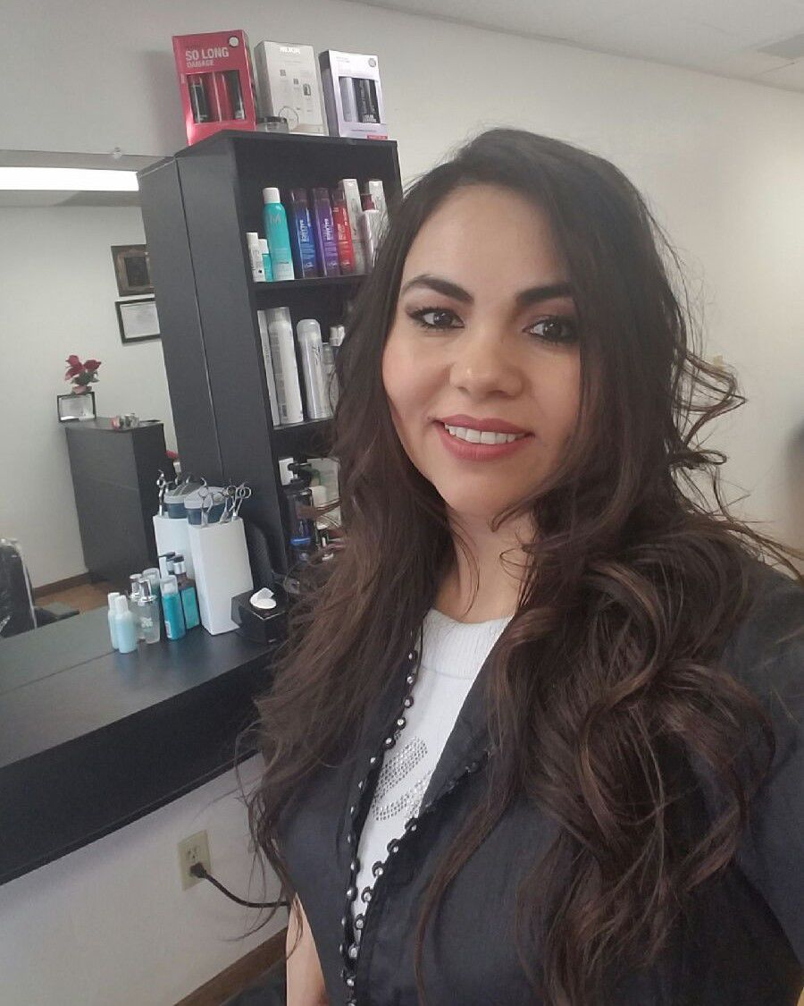 Lorena Villalobos, owner of Lorena's Hair Salon in Fitchburg, is one of the stylists, and knows her clients trust her. FILE PHOTO