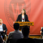 University Health Services Director Sarah Van Orman speaks during a 2015 news conference at Bascom Hall, flanked by Dean of Students Lori Berquam, left, and Chancellor Rebecca Blank. PHOTO: JEFF MILLER