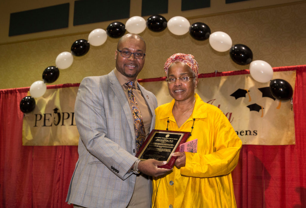 Vice Provost & Cheif Diversity Officer Patrick J. Sims presents keyote speaker Hazel Symonette with the Lane DeWalt Service Award at the annual Rwecognition Banquet PEOPLE Banquet, July 21, 2017. DDEEA photo by Andy Manis.