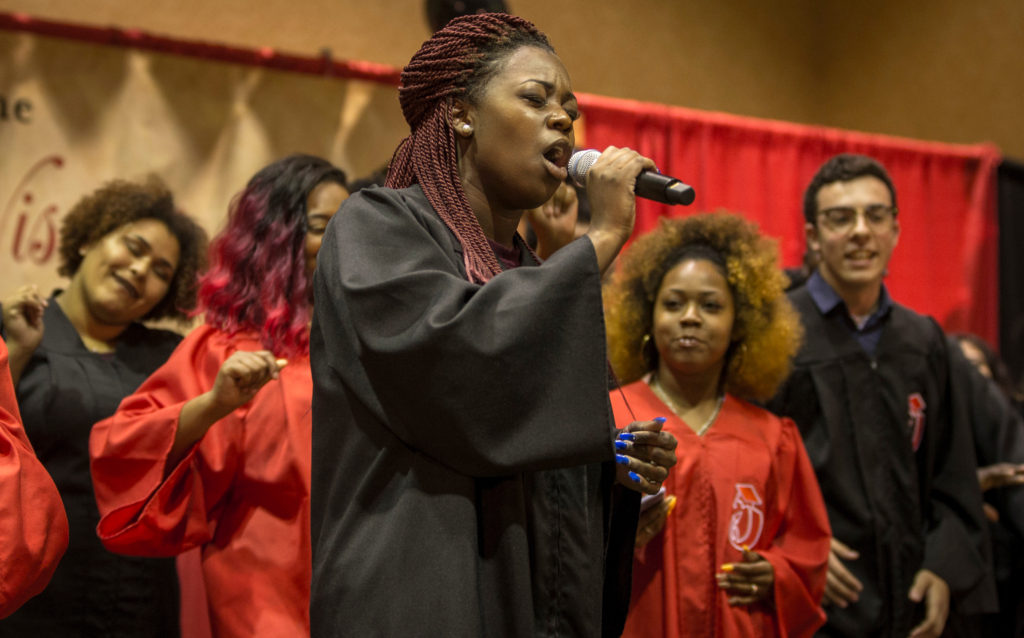The PEOPLE Summer Chorus, directed by Dantrell Cotton, brought a vocal lift to the Rise event, fanning out into the audience with joy at the annual Recognition Banquet July 21, 2017, DDEEA photot by Andy Manis.