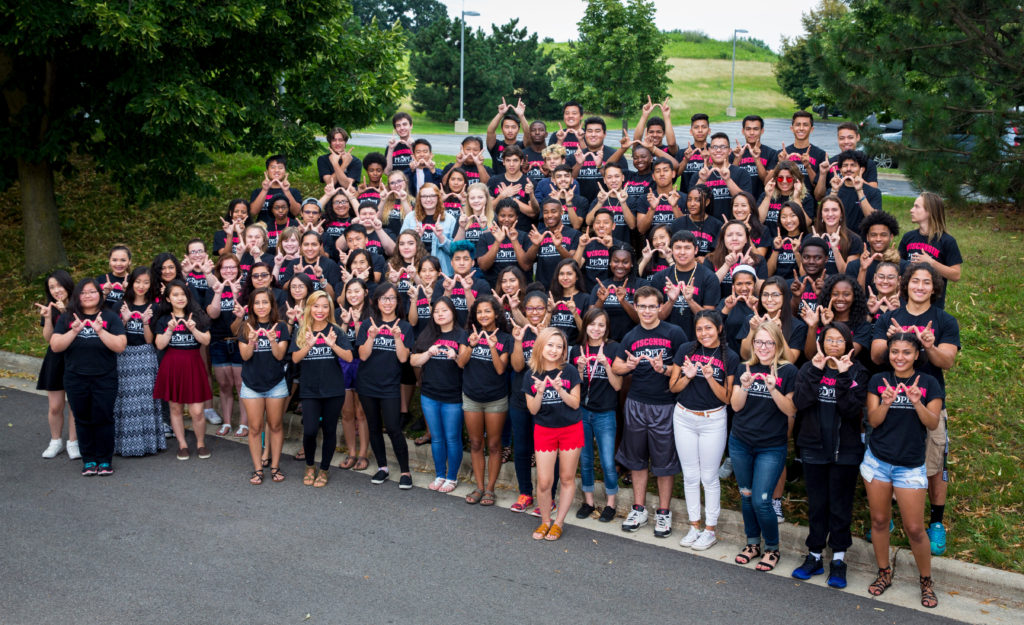 "The 95 incoming freshman members of the record breaking 2017 PEOPLE College Scholars Cohort practice their ""W""s. DDEEA photo by Andy Manis."