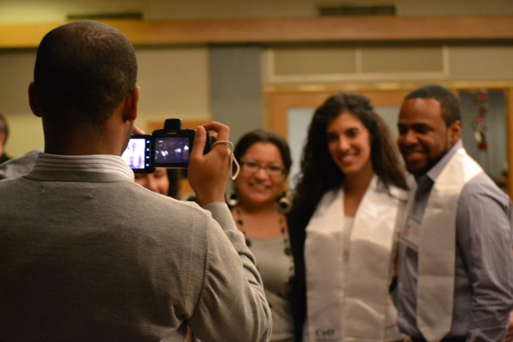 CEO staff, mentors and students gather for the December Graduatiion celebration. Photo by Valeria A.Davis