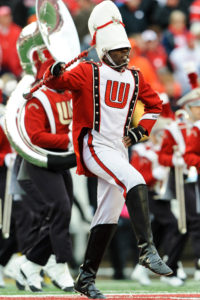 Lead by Drum Major and Posse Scholar Malcolm Robey, members of the UW Badgers marching band play during a football game against the University of Illinois Illini at Camp Randall Stadium at the University of Wisconsin-Madison on Oct. 6, 2012. Wisconsin won the game 31-14. (Photo by Bryce Richter / UW-Madison)