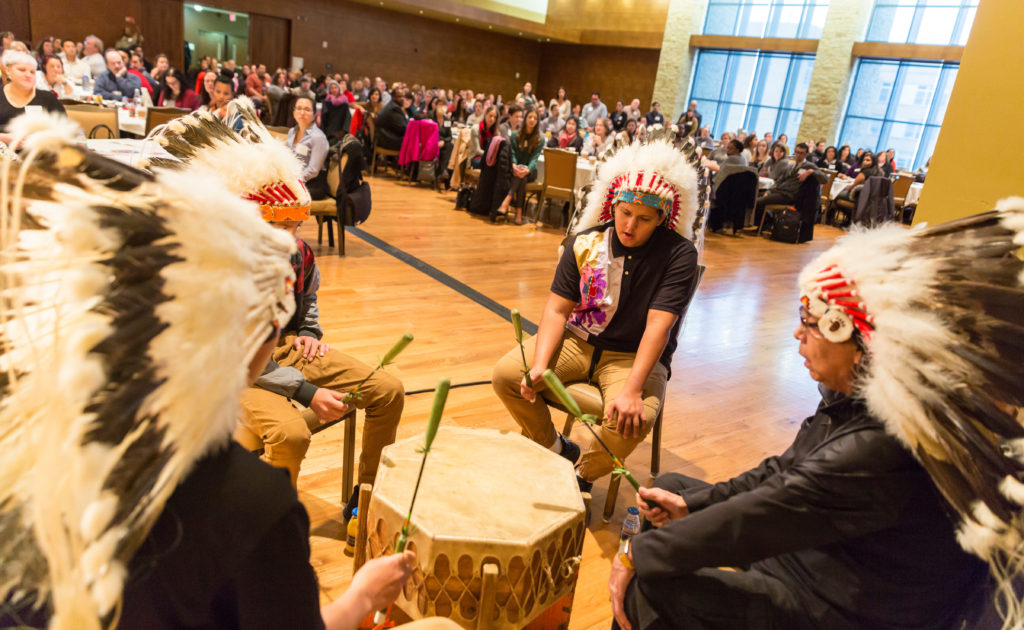 Led by Gerald Cleveland, Sr., the HoChunk Nation Bear Clan Singers acknowledge Native American Heritage Month and the University's establishment on the tribe's ancestral land at the Diversity Forum 2017 Nov. 7, 2017. (Photo © Andy Manis)