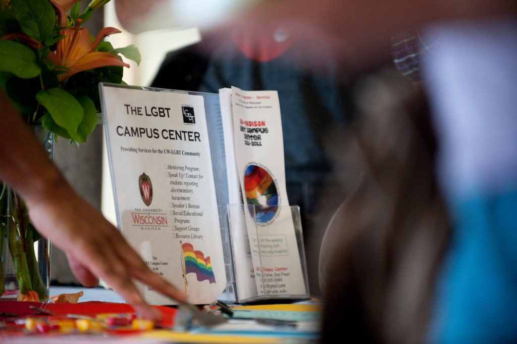 Members of the University of Wisconsin-Madison's lesbian, gay, bisexual and transgender (LGBT) community collect buttons and printed information during an ice cream social and Wisconsin Welcome event sponsored by the LGBT Campus Center in Memorial Union's Great Hall on Sept. 1, 2010.