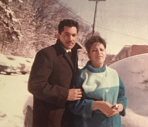 Luciano and Martha Barraza pose in front of their snow-covered car outside their first apartment at Eagle Heights at UW–Madison during the fall semester of 1963. Photo: Submitted