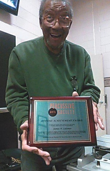 Jim Latimer with his Wisconsin Percussive Arts Society Lifetime Achievement Award