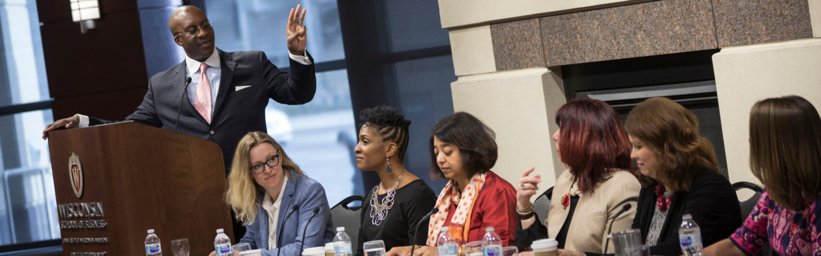 Eddie Turner, the first male to moderate the UW-Madison/National Diversity Council Annual Women in Leadership Symposium, gets ready to start the session.