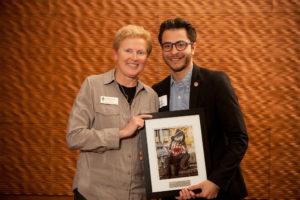 Jesus Del Toro receives has award from Dean of Syudents Lori Berquam.
