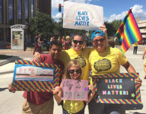 Shawna Lutzow and Johanna Heineman-Pieper with Lutzow's niece and nephew Kellyse and Zekaeus, at Madison Pride.