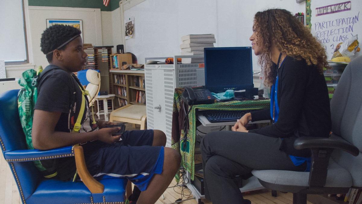 student Ke'Shawn Kumsa talks with teacher Jessica Stovall