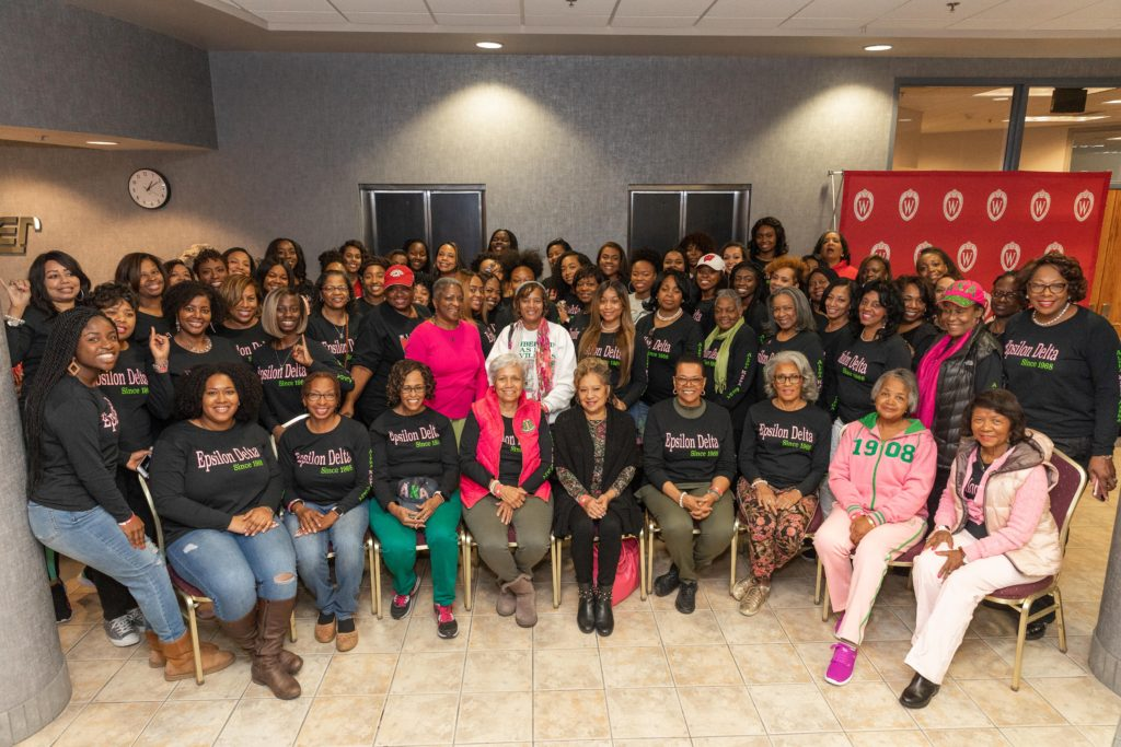 Dozens of women stand and sit in a posed portrait for the Epsilon Delta chapter of the Alpha Kappa Alpha sorority.