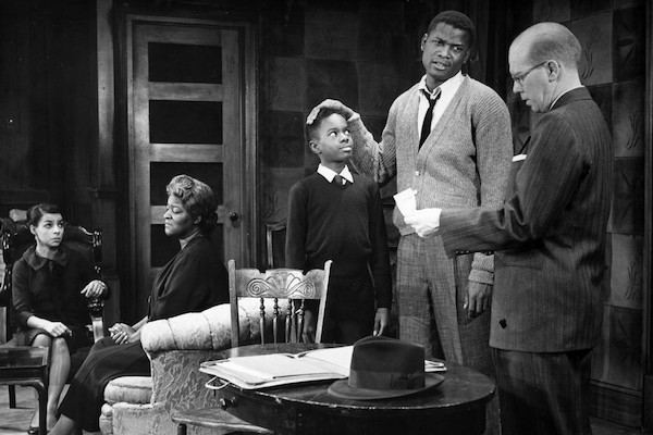 """Scene from a 1959 production of the stage version of """"A Raisin in the Sun."""" From left: Ruby Dee (Ruth Younger), Claudia McNeil (Lena Younger), Glynn Turman (Travis Younger), Sidney Poitier (Walter Younger) and John Fiedler (Karl Lindner). All except Turman reprised their roles in the 1961 film.FRIEDMAN-ABELES PHOTOGRAPH COLLECTION"""