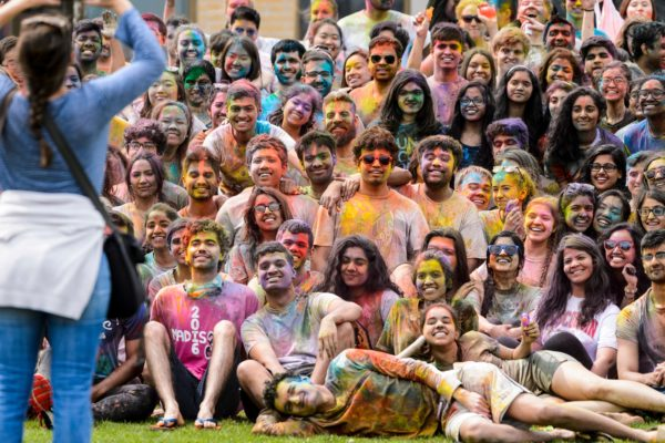Hundreds of students participate in the spirited Hindu tradition of throwing colored powder during Rang de Madison, a Holi festival of color hosted by the Madison Hindu Students Association outside of Dejope Residence Hall at the University of Wisconsin-Madison on April 15, 2017. The event, which celebrates the arrival of spring and victory of good over evil, was held in collaboration with UW-Madison's India Students Association and Indian Graduate Students Association. (Photo by Jeff Miller/UW-Madison)