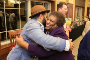 Gloria Hawkins, assistant vice provost and director of the Mercile J. Lee Scholars Program, receives a hug from Gabriel Stulman ('03), New York restauranteur and entrepreneur, at a Multicultural Homecoming event on Oct. 18, 2018, in Camp Randall Stadium.