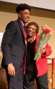 Gloria Hawkins congratulates 2019 Chancellor Scholar Maurice Lucre. Photo by Amadou Kromah.