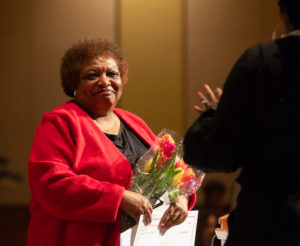 A surprise serenade by Milwaukee singer Kahlia Baker brought tears of joy to Dr. Gloria Hawkins at an unexpected celebration of her retirement. Photo by Amadou Kromah.