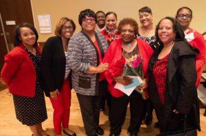 Members of the Delta Sigma Theta Sorority celebrate Gloria Hawkins retirement at a surprise gathering. Photo by Amadou Kromah.