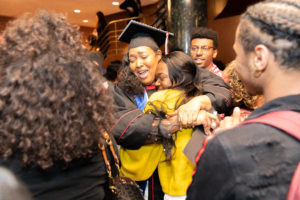 2019 PEOPLE and McNair Graduate Tatiana Lipscomb shares a jubilant hug following the May 10, 2019 recognition ceremony. Phoo by Andy Manis.