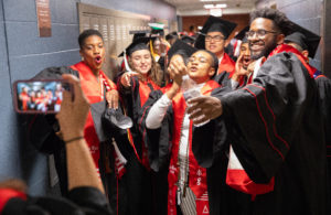 First Wave graduates snap a selfie while waiting to being the processional fat the May 10 Graduation and Recognition ceremony.