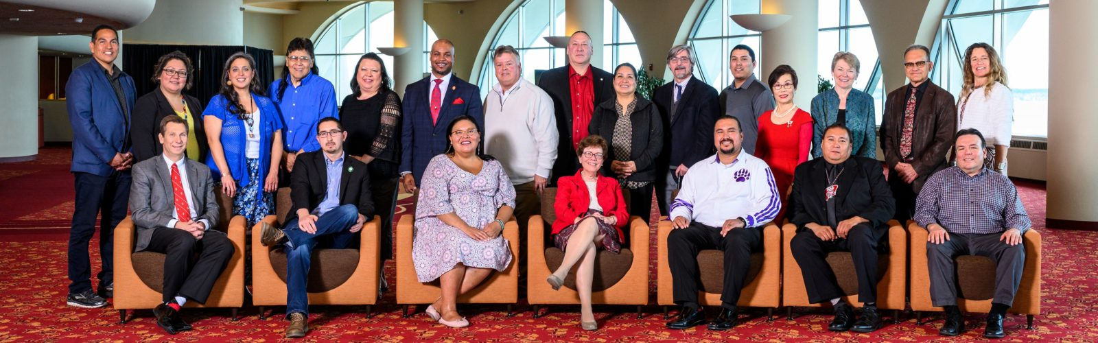Wisconsin tribal leaders and officials from the University of Wisconsin-Madison are pictured in a group photo during a Native Nations Summit held at the Monona Terrace Community and Convention Center in Madison, Wis., on May 10, 2019. (Photo by Jeff Miller / UW-Madison) Pictured standing from left to right are Aaron Bird Bear, UW-Madison Assistant Dean for Student Diversity Programs in the School of Education; LeAnn White, Vocational/Higher Education Transition Coordinator, Lac du Flambeau Band of Lake Superior Chippewa Indians; Jessica Ryan, Tribal Council Member, Brothertown Indian Nation; Don Rosin, Human Resources Manager, Red Cliff Band of Lake Superior Chippewa Indians; Jolene Bowman, Vice President, Stockbridge-Munsee Band of Mohican Indians; Patrick Sims, UW-Madison Deputy Vice Chancellor for Diversity and Inclusion, Vice Provost and Chief Diversity Officer; Thomas Boelter, Administrator of Education and Culture, Forest County Potawatomi; Mic Isham, Executive Administrator of the Great Lakes Indian Fish & Wildlife Commission and past chairman of the Lac Courte Oreilles Band of Lake Superior Chippewa; Yvette McGeshick, Education Director, Sokaogon Chippewa Community Mole Lake Band of Lake Superior Chippewa; Paul Robbins, UW-Madison Dean of the Nelson Institute for Environmental Studies; Gunnar Peters, Legislator, Menominee Indian Tribe of Wisconsin; Soyeon Shim, UW-Madison Dean of the School of Human Ecology; Sarah Mangelsdorf, UW-Madison Provost; Larry Nesper, UW-Madison Director of American Indian Studies and Professor of Anthropology; and Jessie Conaway, Co-Chair Native Nations_UW Working Group and UW-Madison Faculty Associate, Nelson Institute for Environmental Studies. Pictured seated from left to right are Charles Hoslet, UW-Madison Vice Chancellor of University Relations; Dylan Jennings, Tribal Council Member, Bad River Band of Lake Superior Chippewa; Nehoma Thundercloud, Tribal Advisory Council Member, Ho-Chunk Nation; Rebecca Blank, UW-Madison Ch