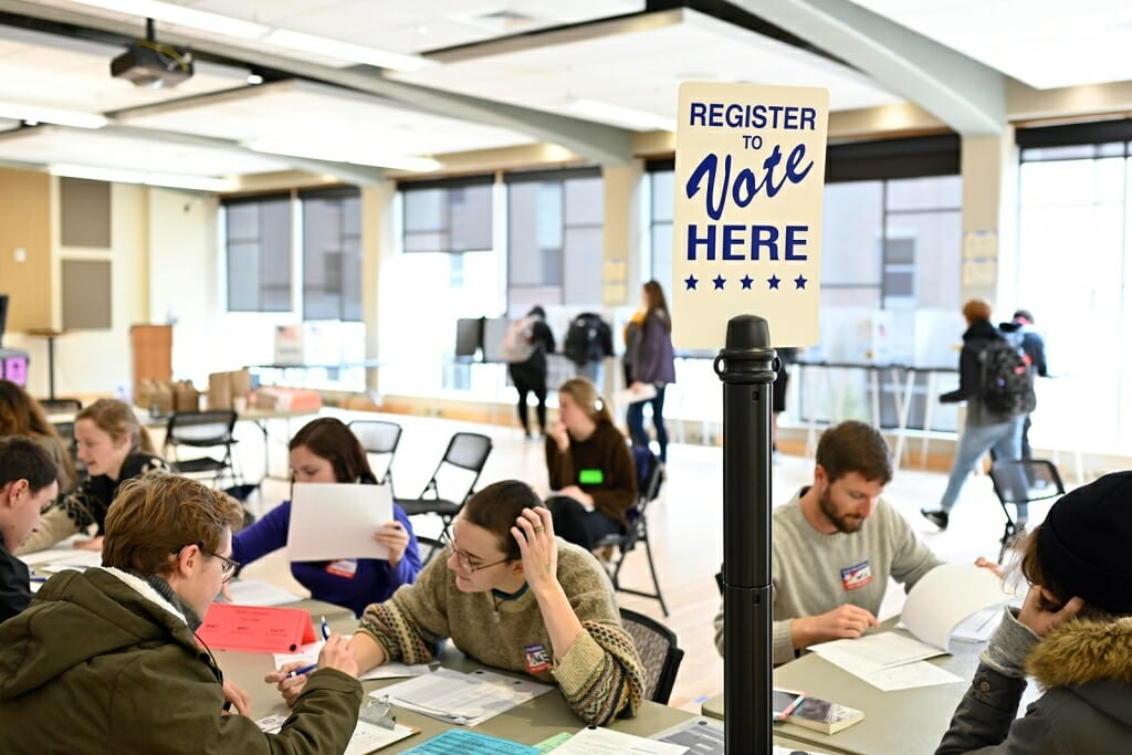 Students register to vote before filling out midterm election ballots at the Frank Holt Center on campus on Nov. 6, 2018. Photo: Jeff Miller