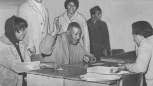 African American voters swearing in at the polls.