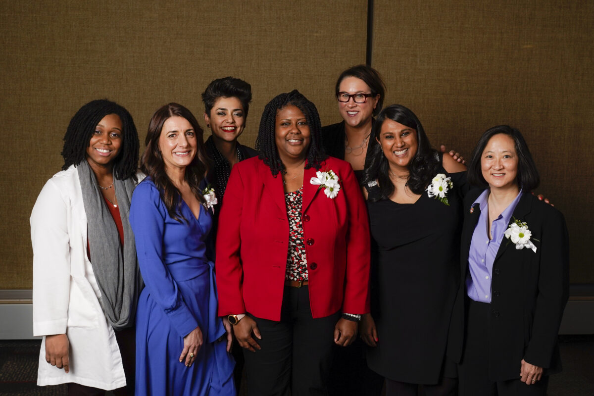 Seven Outstanding Women of Color awardees pose for a group photo