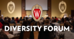 """The UW crest and bold white letters reading """"DIVERSITY FORUM"""" are overlaid on a blurred image of a conference in a large room."""