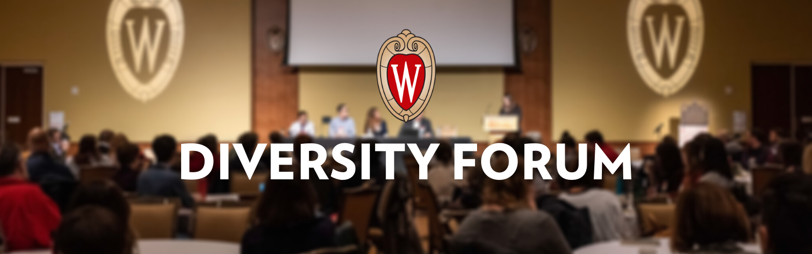 """A intentionally blurred image of a conference room with UW crests and the word """"Diversity Forum"""" superimposed in bold white letters."""