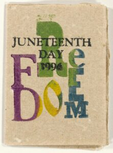 """A hand-made art book with block prints in purple, green, yellow and blue reading """"Juneteenth Day 1996 / FREEDOM"""""""