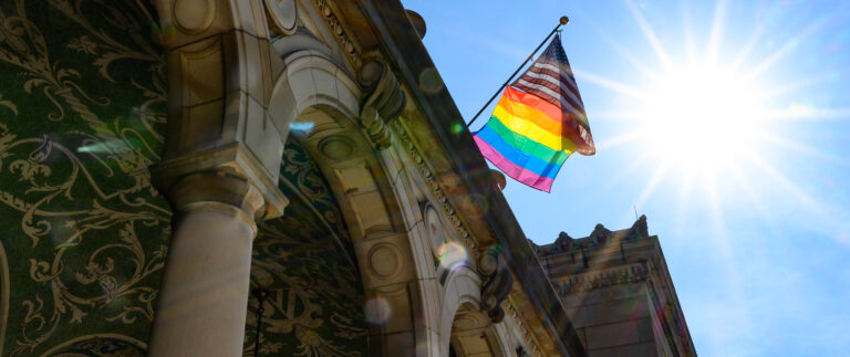 The Pride Flag is displayed outside of Memorial Union